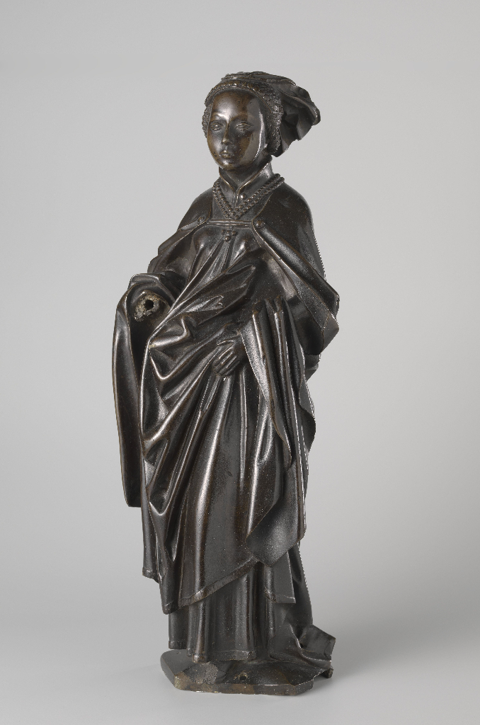 Mourner from the Tomb of Isabella of Bourbon, c. 1475–76. Attributed to Jan Borman the Younger (Netherlandish, active 1479–1520); casting attributed to Renier van Thienen (Flemish, active 1460–1541). Brass copper alloy; 55.5 cm x 20.5 cm x 13.5 cm. On loan from the City of Amsterdam, BK-AM-33-I