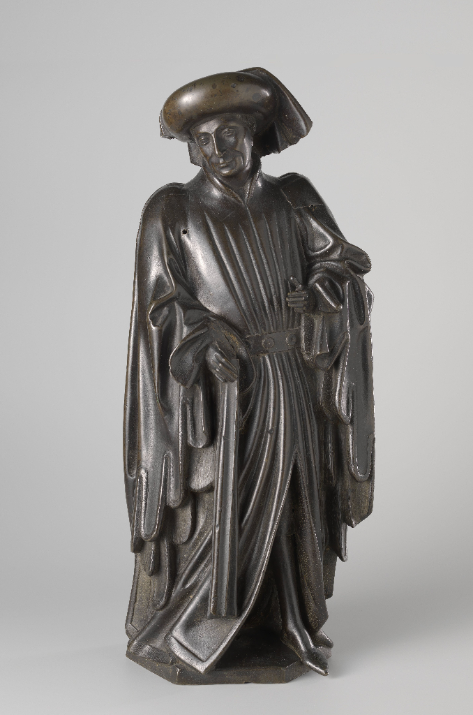 Mourner from the Tomb of Isabella of Bourbon, c. 1475–76. Attributed to Jan Borman the Younger (Netherlandish, active 1479–1520); casting attributed to Renier van Thienen (Flemish, active 1460–1541). Brass copper alloy; 55 cm x 22.5 cm x 12.5 cm. On loan from the City of Amsterdam, BK-AM-33-D